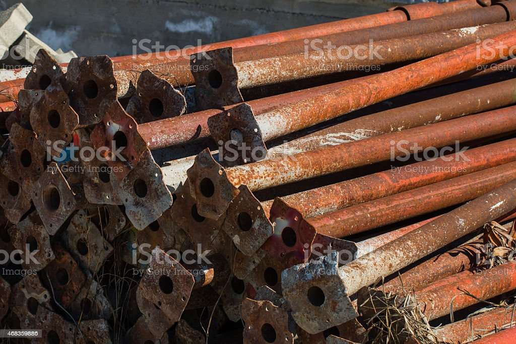 old scaffold tubes storaged outside in a pile royalty-free stock photo