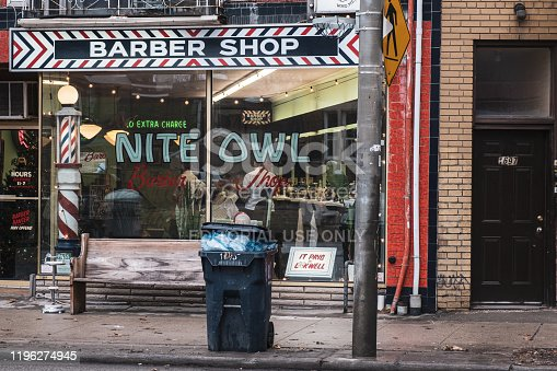 Toronto, ON 12/27/2019: Street scene of old school style barber in Little Portugal. Busy small business with retro look.