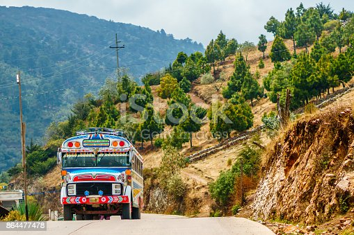 View on old school bus used as public transport by Todos Santos Cuchumatan in Guatemala