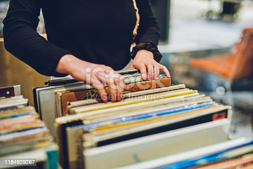 Shot of a young woman shopping for vinyl records at a store