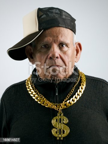 grandfather with a cap and golden chains