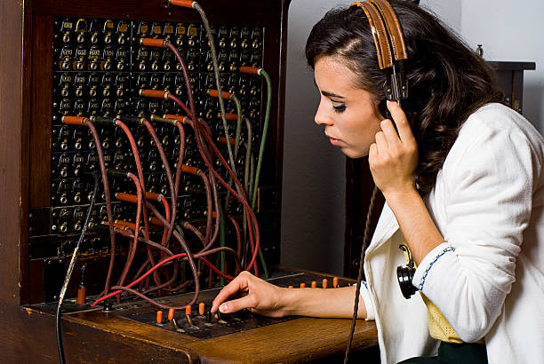 old school telephone operator - switchboard operator stock photos and pictures