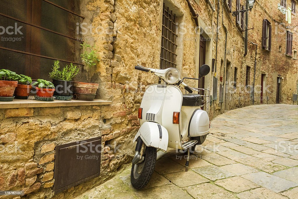 Old scooter on the street in Italy stock photo