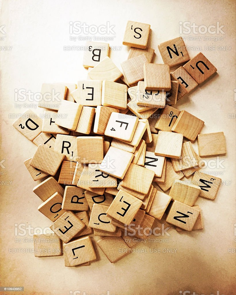 Old Scrabble Tiles in Pile stock photo