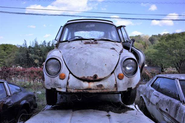 Old scrapped car, Abandoned retro car for recycling in waste disposal site stock photo