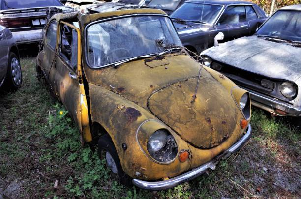 Old scrapped car, Abandoned retro car for recycling stock photo