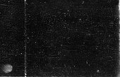 A close-up scan of an old scratched 35mm film strip grunge texture background.