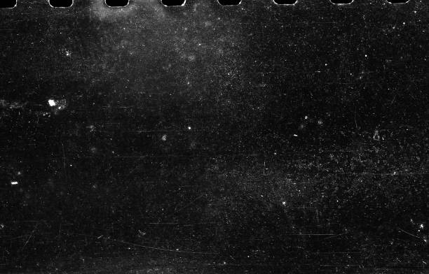 Old Scratched Film Strip Grunge Texture Background A close-up scan of an old scratched 35mm film strip grunge texture background. toned image stock pictures, royalty-free photos & images