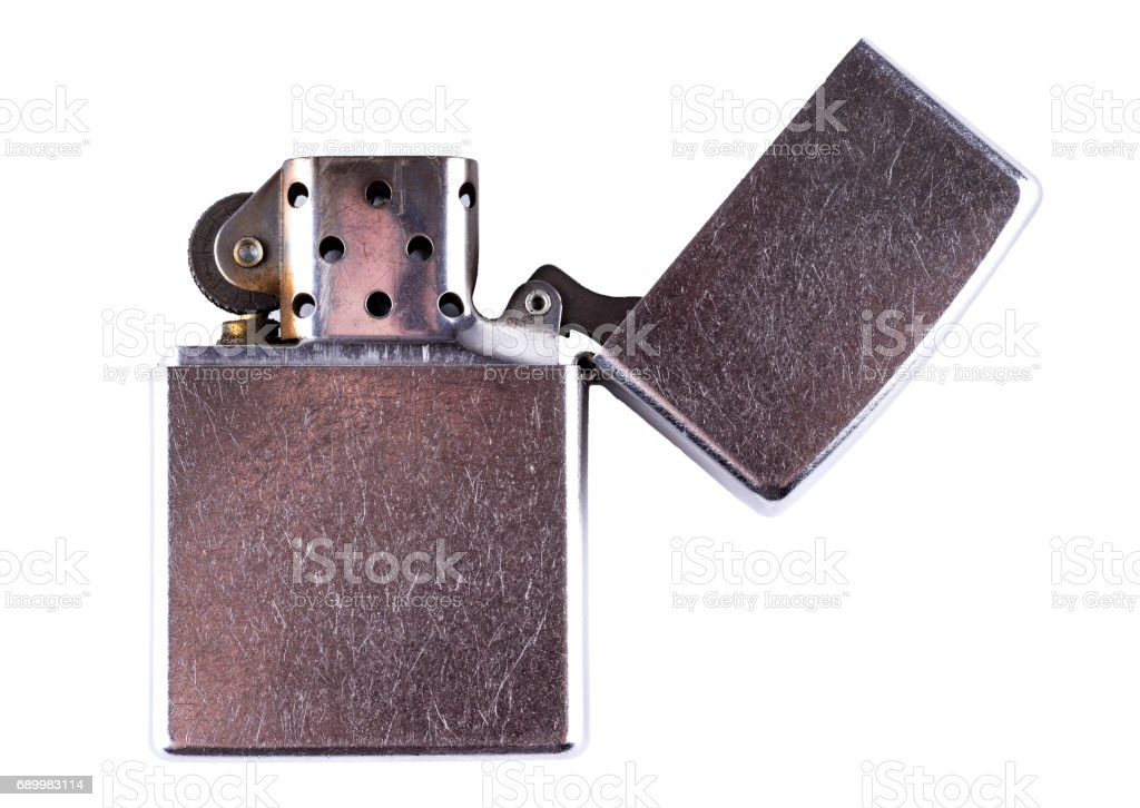 Old scratched gasoline cigarette lighter isolated on white. stock photo