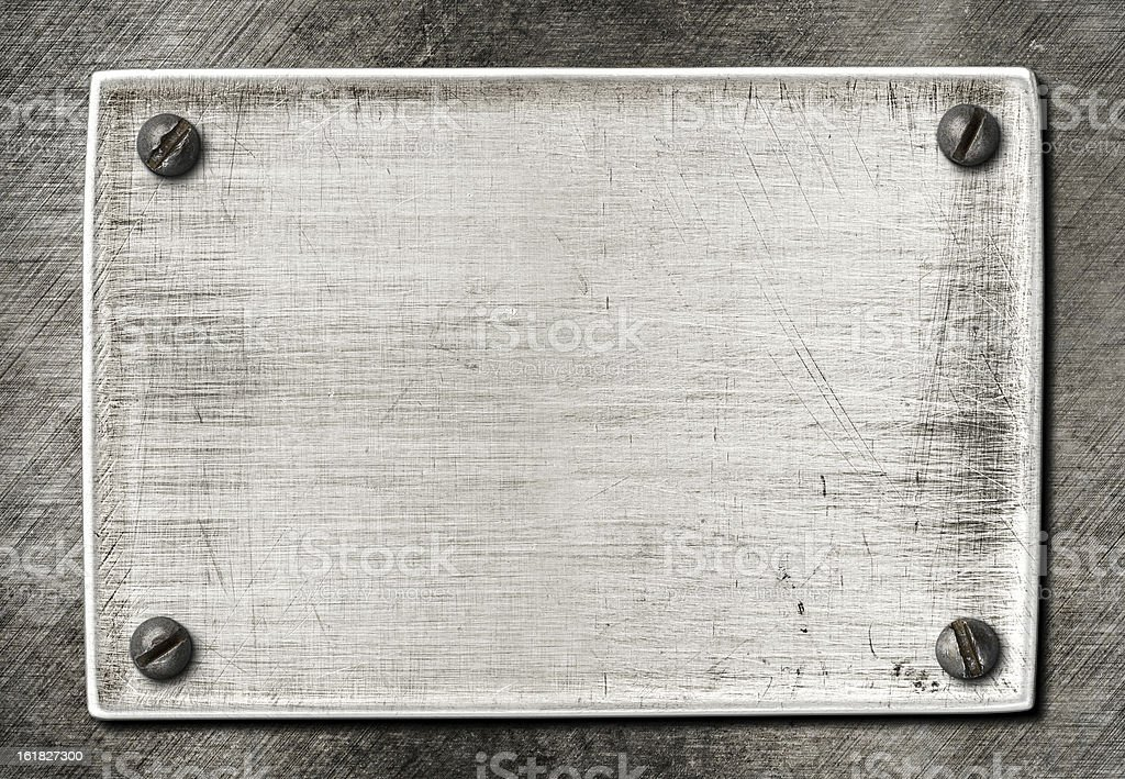 old scratched metal plate texture with screws stock photo