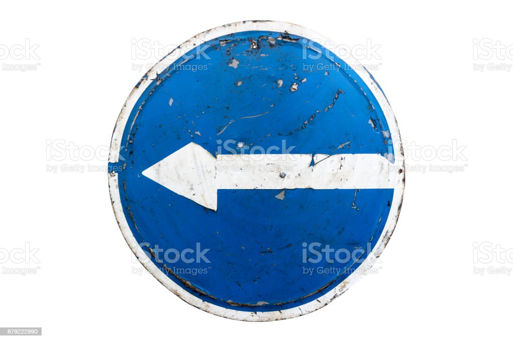 Old scratched round blue road sign 'Turn Left' isolated on white. stock photo