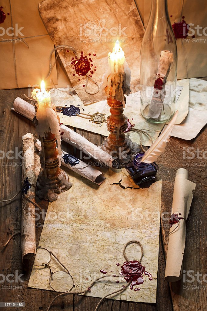 Old scrolls and candles are the scribe's workplace royalty-free stock photo