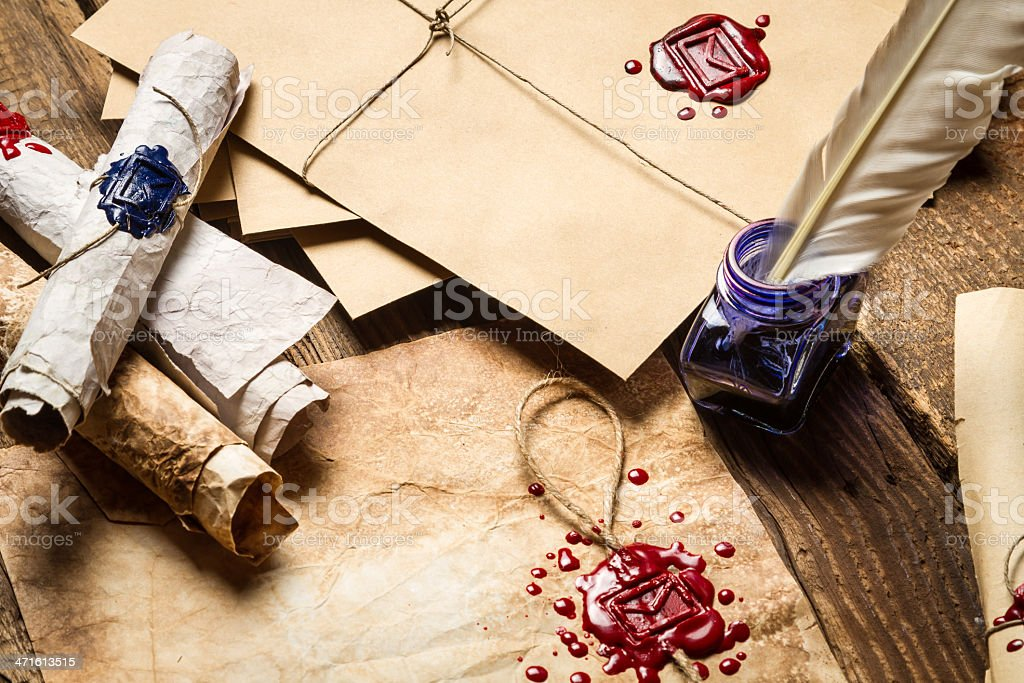 Old scrolls, sealing wax, envelope and blue ink royalty-free stock photo