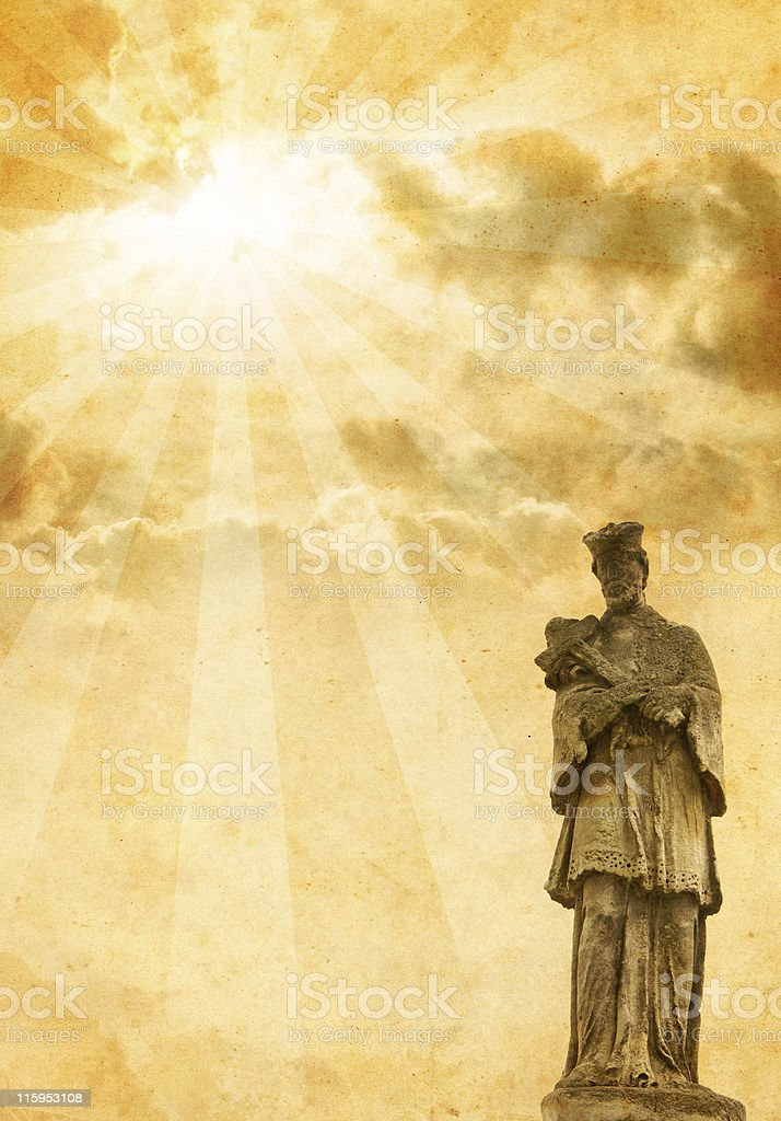 old sculpture with sunbeams and clouds royalty-free stock photo