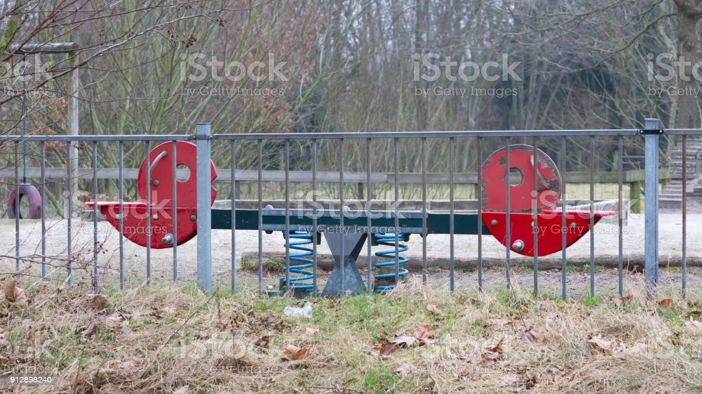 Old seesaw in a playground in the Netherlands stock photo
