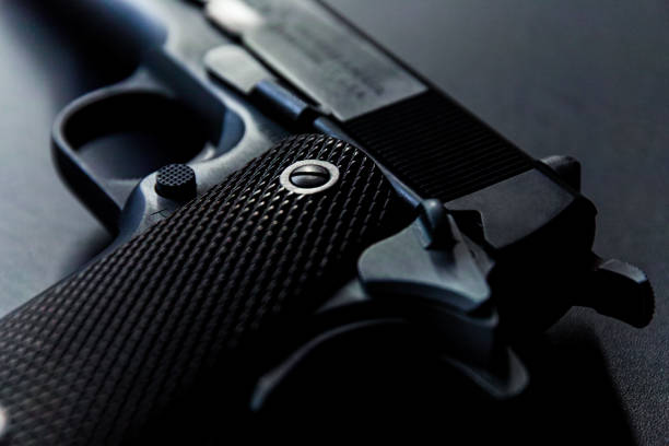 Old semi automatic hand gun Close up of old semi auto pistol gun shop stock pictures, royalty-free photos & images
