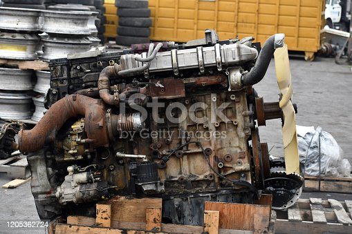istock Old semi-engine laying on a palette 1205362724