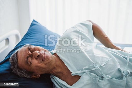 821012164istockphoto Old senior asian patient suffering from back pain, back ache 1019859670