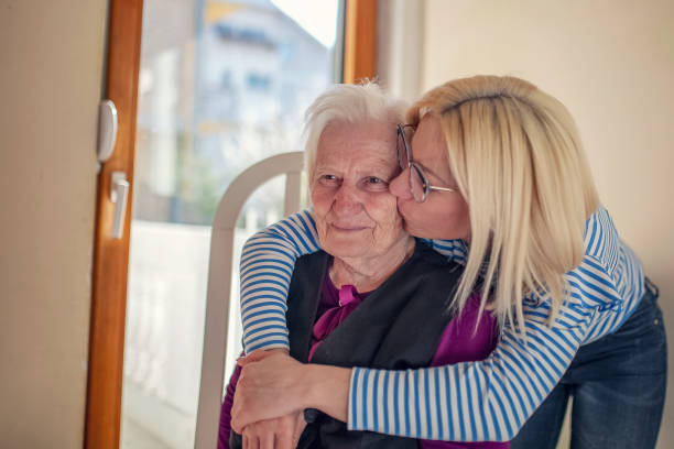 Old senior woman celebrating her 87th birthday with her loved ones Old woman celebrating her 87th birthday with her family birthday wishes for daughter stock pictures, royalty-free photos & images