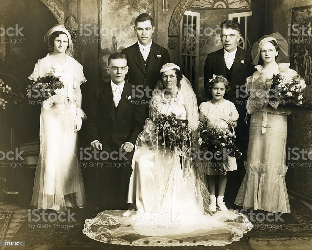 Old sepia photograph of a group at a wedding stock photo