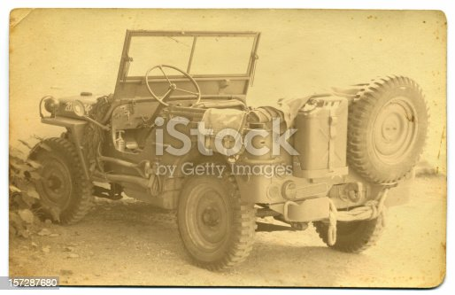 Grungy, vintage-styled photo of well-equipped World War II era U.S. Army Jeep