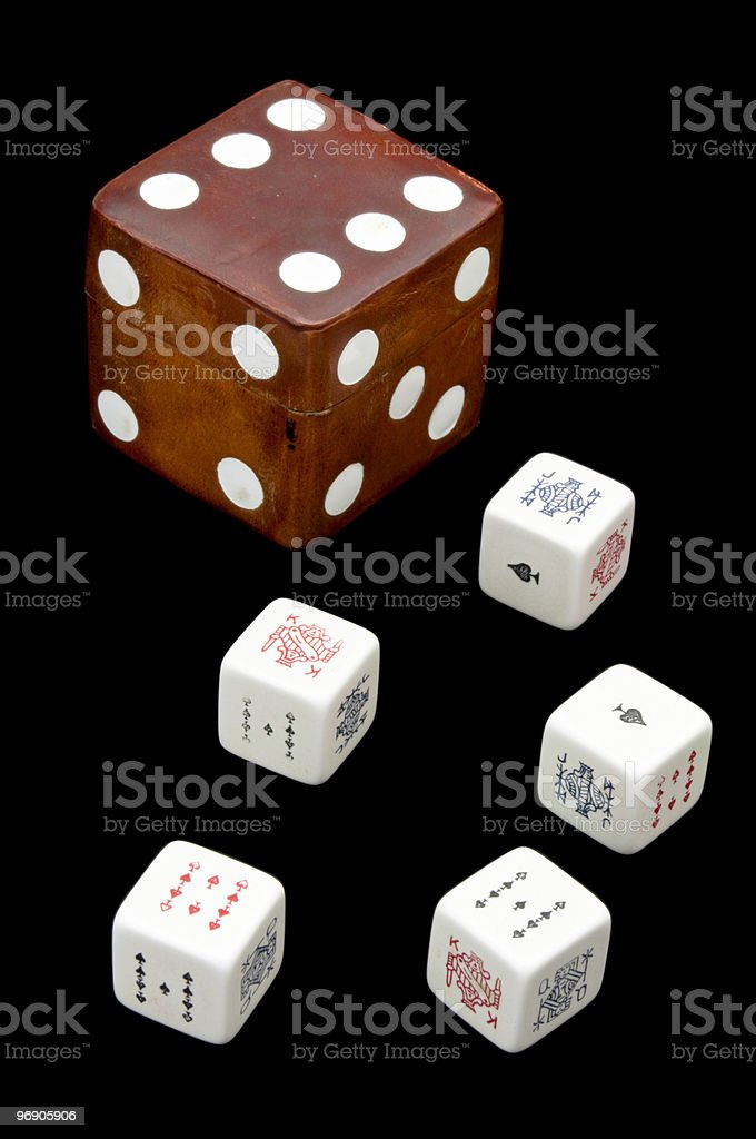 Old set of poker dice with leather box royalty-free stock photo