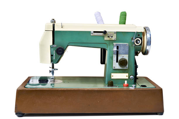 old sewing machine isolated - sewing machine needle stock photos and pictures
