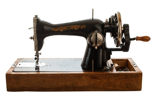 Old sewing machine on white background. stock photo