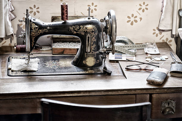 old sewing machine - sewing machine needle stock photos and pictures