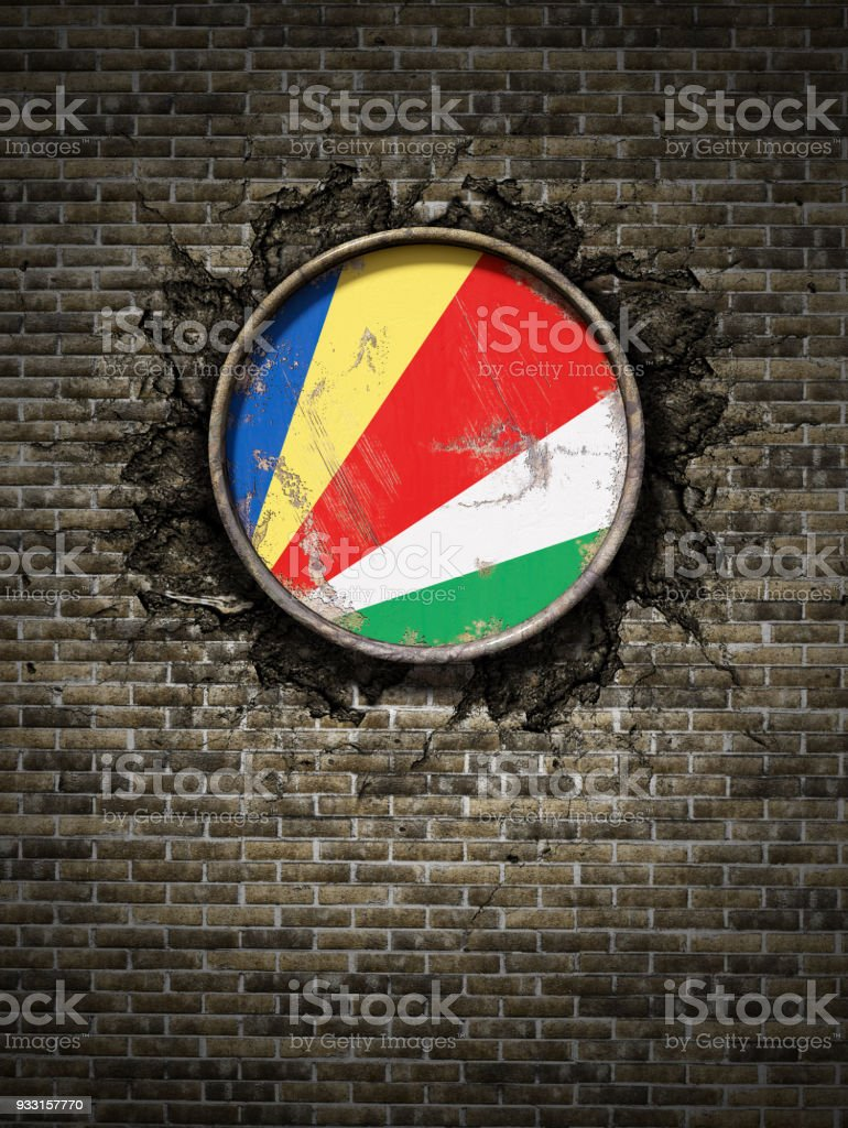 Old Seychelles flag in brick wall stock photo