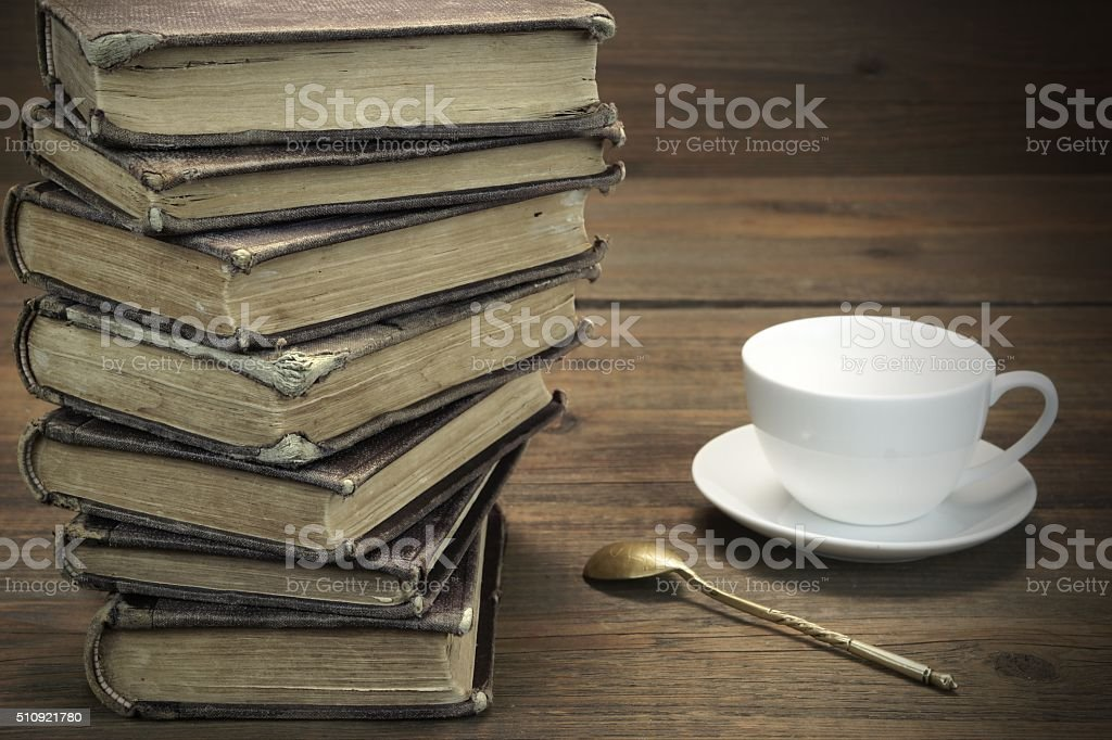Old Shabby Books And White Cup On The Wood  Background stock photo