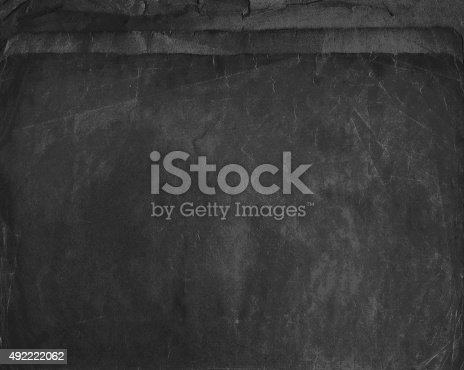 istock Old shabby papers in dark grey colour, grunge background 492222062