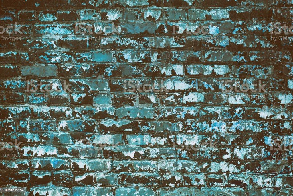Old shabby turquoise painted brick wall - retro grunge background stock photo