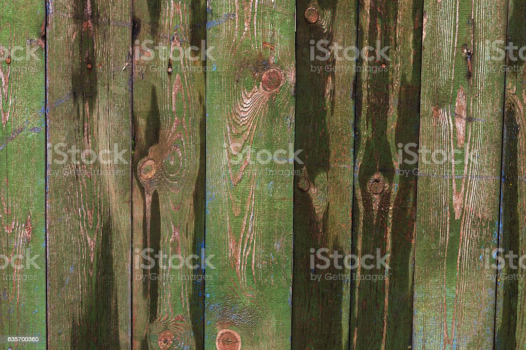 Old shabby wooden fence background with a trace of ads. royalty-free stock photo