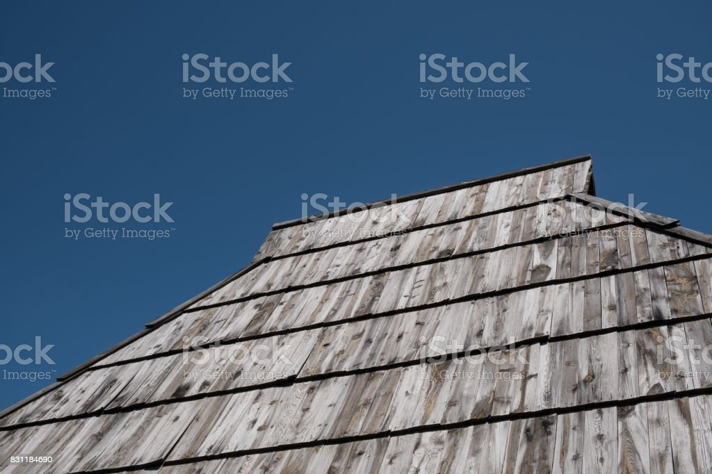 Old shake roof with weathered wooden planks stock photo
