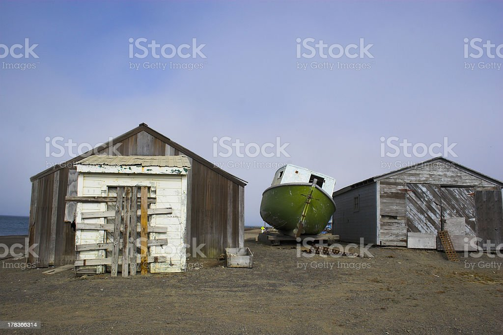 Old sheds and a boat stock photo