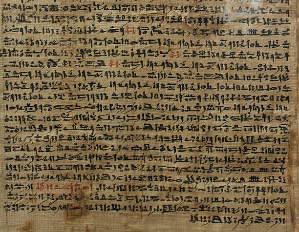Old sheet of Egyptian papyrus with script an ancient egyptian papyrus  papyrus paper stock pictures, royalty-free photos & images