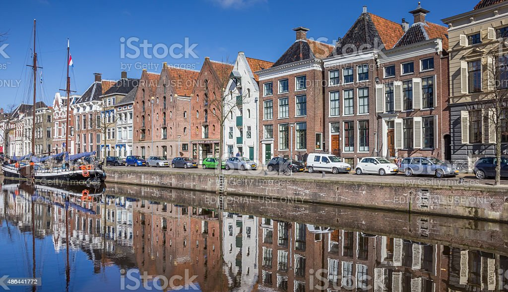 Old ship and warehouses along a canal in Groningen stock photo