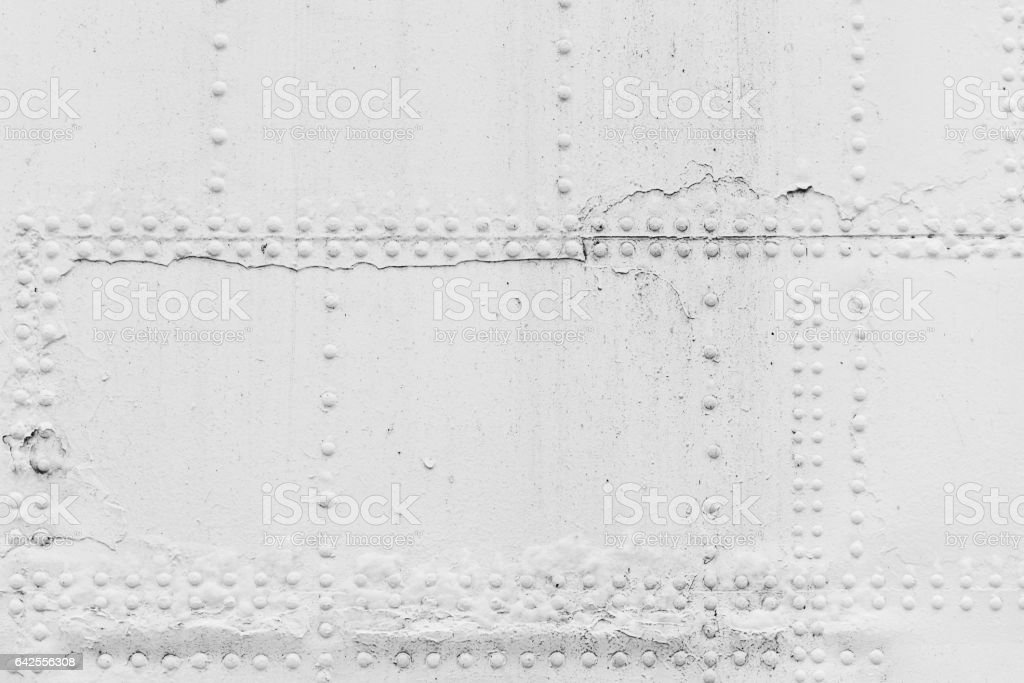 Old ship hull fragment, white iron sheets stock photo