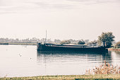 Old fishing ship in a harbor of a dutch village. Horizontal shot