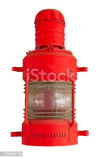 615497916 istock photo old ship lantern isolated on a white background. vintage red signal lamp. 1225389135