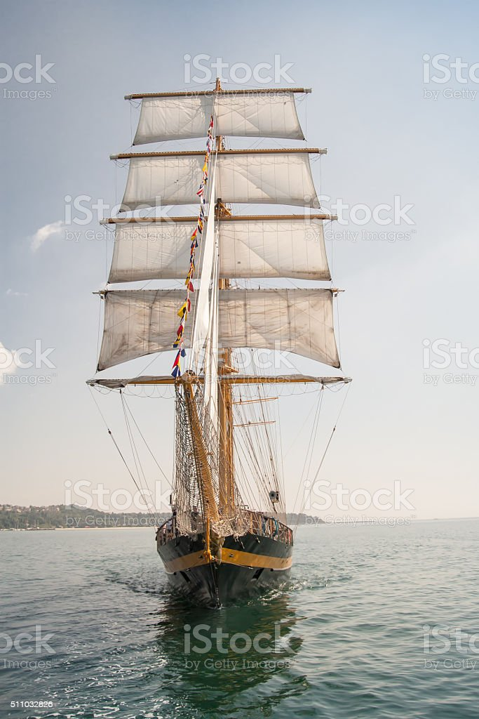 Old ship, sailing in the sea stock photo