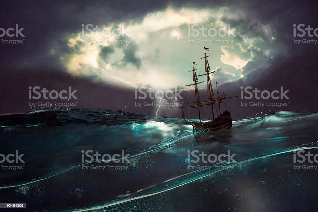 Old ship sailing in the storm stock photo