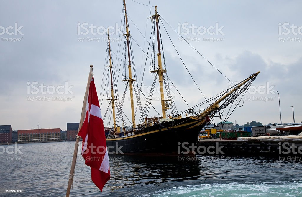 old ship with danish flag stock photo