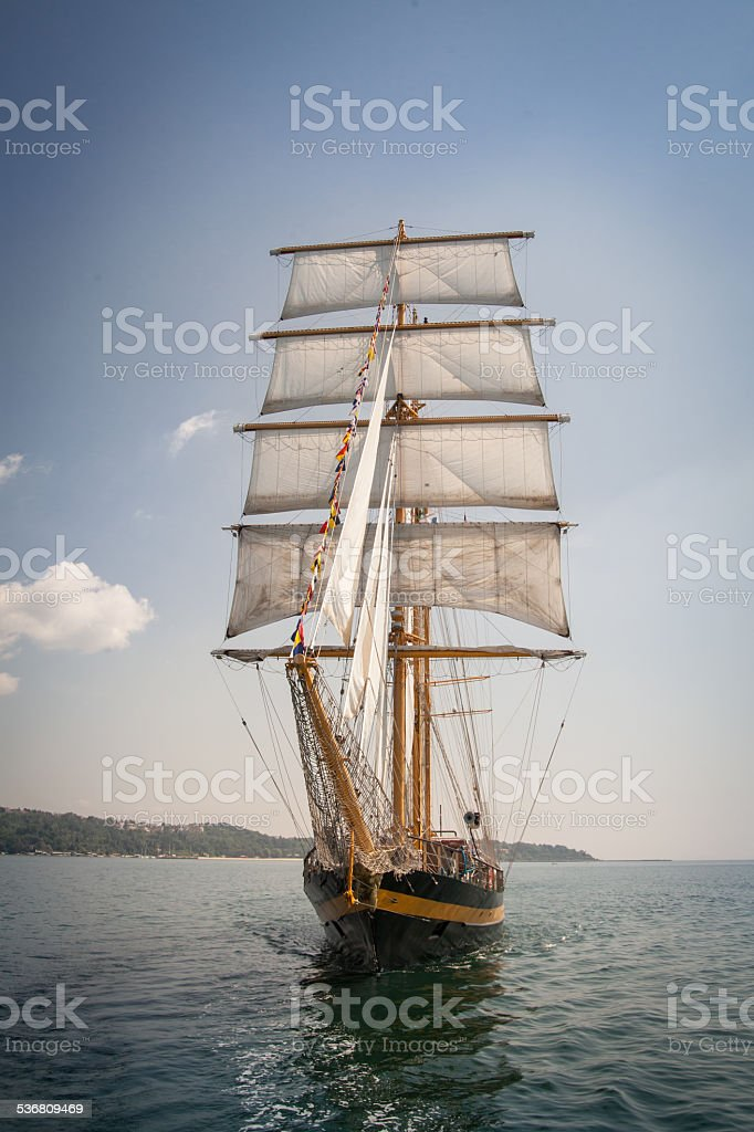 Old ship with white sales, sailing in the sea stock photo
