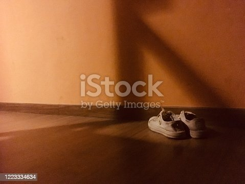 Old shoes abandoned : dark tone, sad and lonely feel, depressive disorder concept