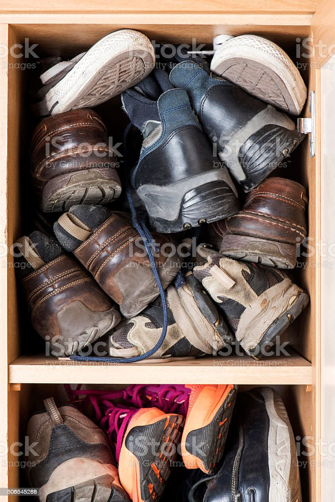 Old Shoes Cabinet stock photo