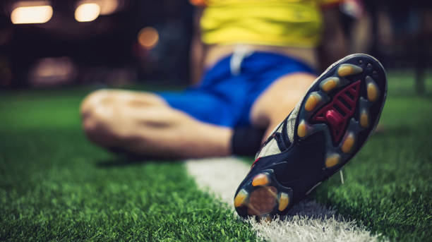Old shoes on grass for exercise for soccer ,selection focus.copy space. stock photo
