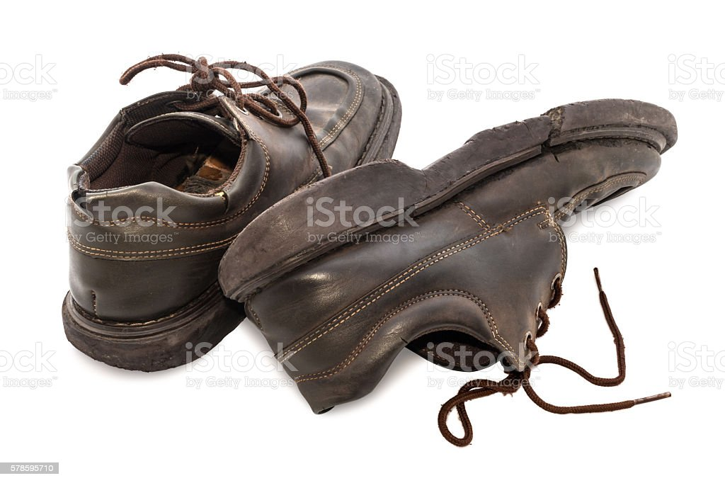 Old shoes - Still life pair of brown leather shoes stock photo