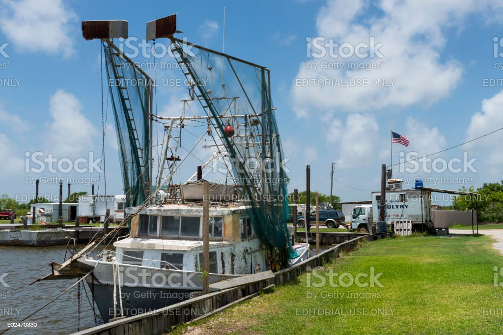 Old shrimp trawler in a port in the banks of Lake Charles in the State of Louisiana stock photo